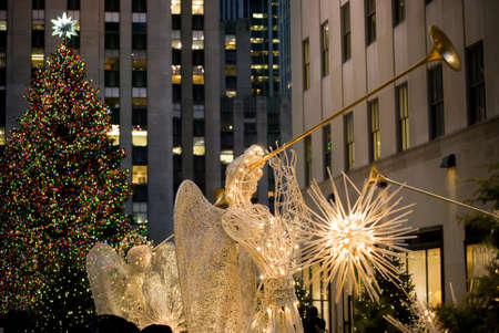 angel tree: MANHATTAN - DECEMBER 3:  The Rockefeller Center Christmas tree and angel with horn decoration as seen on December 3, 2010 in New York City.