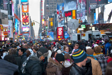 times square: TIMES SQUARE - DECEMBER 31:  Huge crowds form in Times Square In Manhattan for New Years Eve on December 31, 2010 in Times Square, New York City.