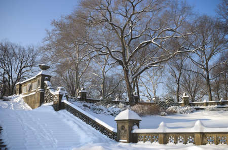 A Central Park Winter view showing the architecture in the park covered in snow. photo