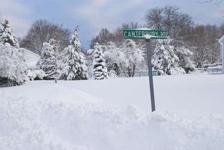 A street sign in Manalapan New Jersey buried deep in snow.
