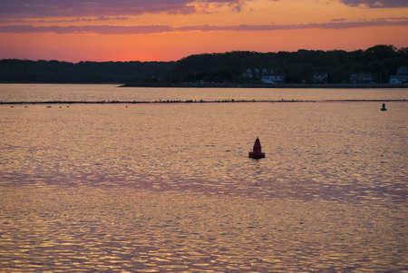 The sun setting over the Shark River in Belmar New Jersey. Stok Fotoğraf