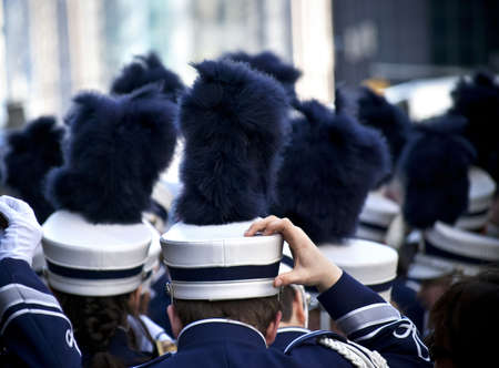 marching band: A close-up of marching band members and their shako helmets before a parade.