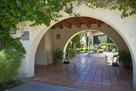 A Southwest style archway and landscaping in Southern California building.