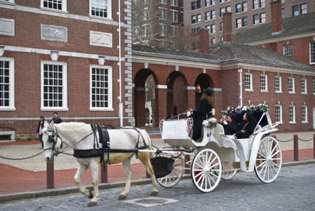 PHILADELPHIA - MARCH 11: A white horse and carriage tour of old city, Philadelphia on March 11, 2011. Editorial