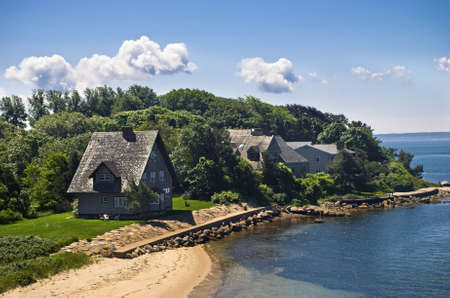 cape cod home: A view of homes along the shoreline of Woods Hole on Cape Cod in Massachusetts.