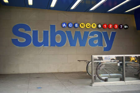 A colorful New York City subway sign outside the 42nd St. in Manhattan.