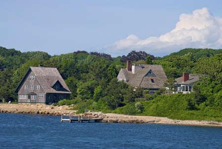 cape cod home: Homes along the shoreline of Woods Hole, Cape Cod, Massachusetts.  Bridge and Meadow