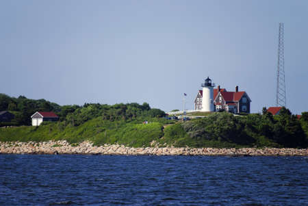 cod hole: A waters view of the Nobska Lighthouse near Woods Hole on Cape Cod in Massachusetts.
