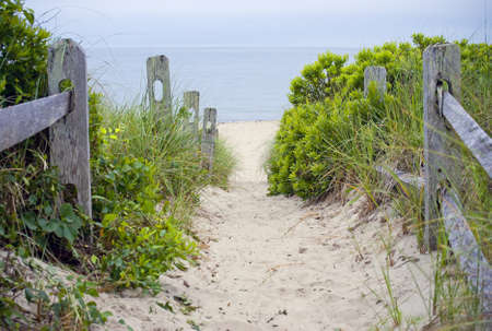 A beach pathway leading to the sea on Cape Cod in Massachusetts. Stock Photo