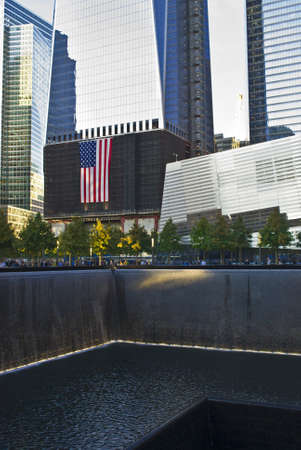 NEW YORK - OCTOBER 6: A view of the Freedom Tower from the 911 Memorial still under construction on October 6, 2011.