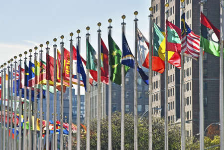 Colorful flags of the world outside of The United Nations Building in New York City.