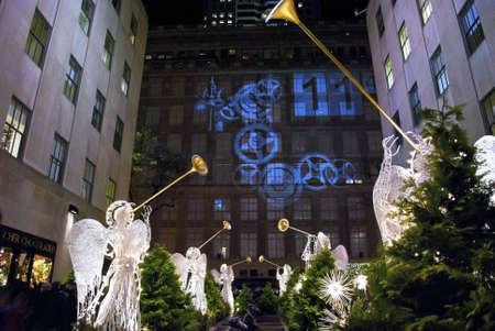 christmas angels: Rockefeller Center, New York, Dec 2 2011: Rockefeller Center all decorated surrounding the newly lit Christmas tree.