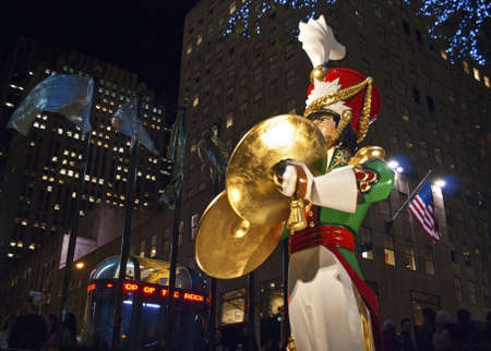 NEW YORK-DEC 2 2011: A Large toy drummer statue and the holiday lights in Rockefeller Center on December 2, 2011. Stock Photo - 11389869