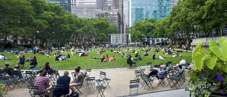 bryant park: NEW YORK - JUNE 16: People enjoying a nice day in Bryant Park on June 16, 2011 in New York City. Bryant Park is a 9,603 acre privately managed park in the center of Manhattan.