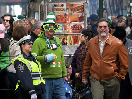 annual events: NEW YORK - MARCH 17: Large crowds dressed in green for the St. Patricks Day Parade on March 17, 2011 in New York City.The St. Patricks Day Parade is one of the most popular annual events in the city.