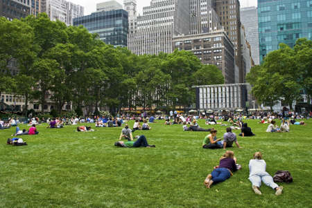NEW YORK - JUNE 16: People enjoying a nice day in Bryant Park on June 16, 2011 in New York City. Bryant Park is a 9,603 acre privately managed park in the center of Manhattan.