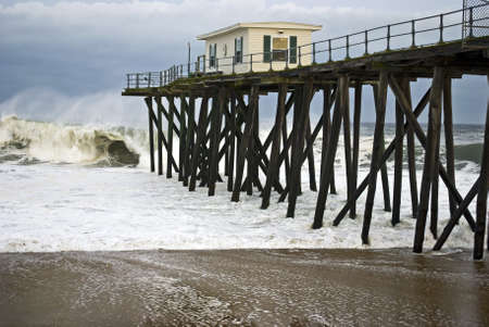 Crashing waves off the fishing pier along the shoreline in Belmar, New Jersey.