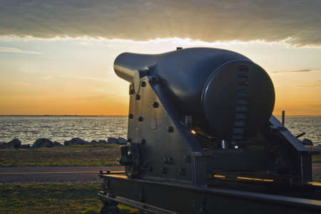 hancock: A historic canon on display at sunset in Fort Hancock on Sandy Hook along the Jersey shore.