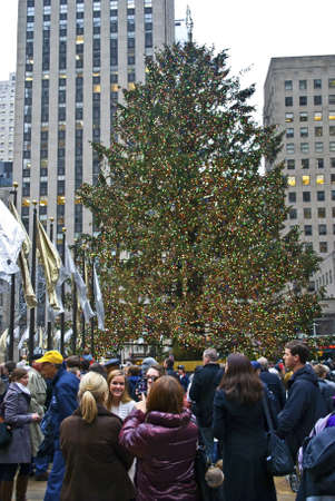 NEW YORK - DECEMBER 26: Holiday crowds around the Christmas Tree in Rockefeller Center on December 26, 2011 in  New York City.