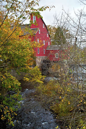 Red Mill Autumn,  A Fall view through the trees of the historic Red Mill in Clinton Township in New Jersey.
