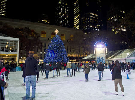 bryant park: NEW YORK - NOVEMBER 30: Ice skaters on the rink in Bryant Park near the Christmas tree on November 30, 2012 in  New York City.