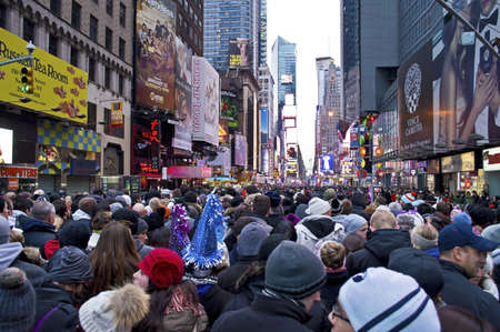 NEW YORK - DECEMBER 31: Crowds gather in Times square on New Years Eve, December 31, 2012 in New York City.