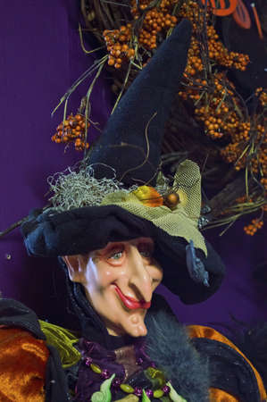 A smiling witch statue with a tall witches hat on display. Stock Photo - 18260518