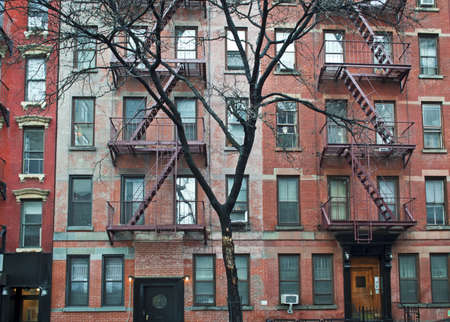 building on fire: A view of a Winter tree and old brick apartment buildings in Manhattan. Editorial