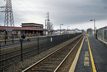A railroad track perspective view of the Bound Brook Train Station in New Jersey.