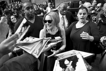 ed: NEW YORK - APRIL 9: Lindsay Lohan greets fans after her David Letterman appearance outside the Ed Sullivan Theater on April 9, 2013 in Manhattan.