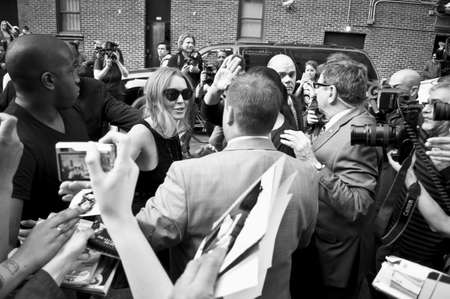 lindsay: NEW YORK - APRIL 9: Lindsay Lohan greets fans after her David Letterman appearance outside the Ed Sullivan Theater on April 9, 2013 in Manhattan.
