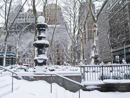 bryant park: A snowy view of Bryant Park in Manhattan after freshly fallen snow.