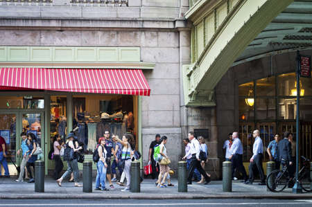 People walk by Grand Central Terminal in Manhattan in the afternoon rush hour.