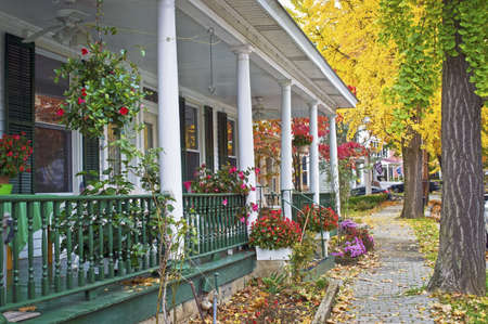An old fashioned porch and cobblestone sidewalks along this street in Clinton New Jersey