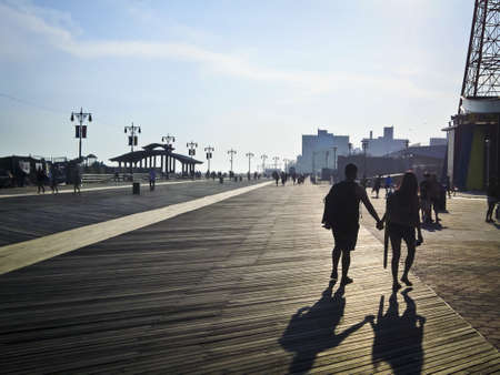 coney: A couple is silhouetted by the sun on a hot Summer day along the Coney Island boardwalk