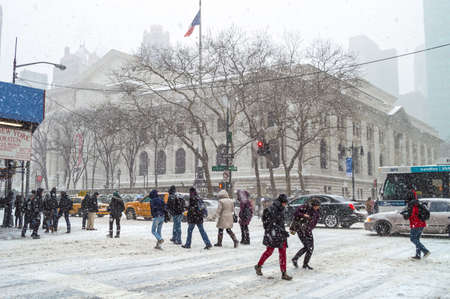 janus: NEW YORK-JANUARY 21  Commuters deal with the snow near the NY Public Library during Winter Storm Janus on January 21, 2014 in Manhattan