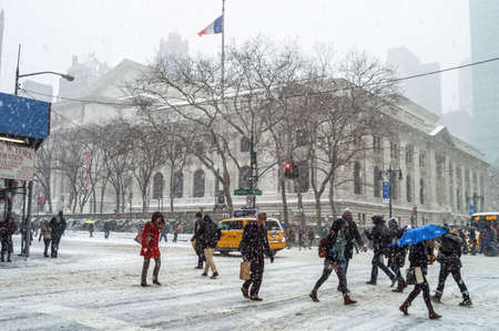 janus: NEW YORK-JANUARY 21  Commuters deal with the NY Public Library during Winter Storm Janus on January 21, 2014 in Manhattan