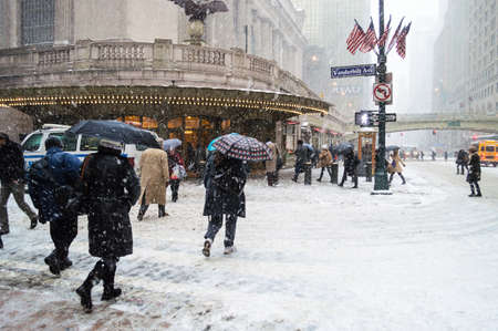 janus: NEW YORK-JANUARY 21  Commuters deal with the snow near Grand Central Terminal during Winter Storm Janus on January 21, 2014 in Manhattan