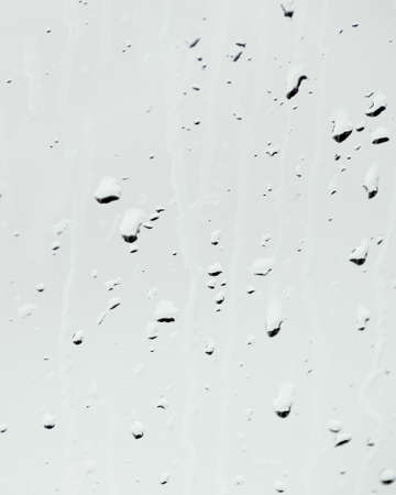 Raindrops on a neutral gray background