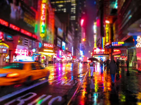 city lights: A colorful abstract look of 42nd St  on a rainy night in New York City
