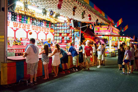 Teenagers at a carnival stand at a state fair in New Jersey  Editorial