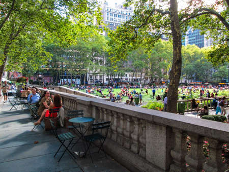 bryant: NEW YORK-AUGUST 14  People relax on a nice day in Bryant Park on August 14  2013 in Manhattan  Bryant Park is a popular tourist destination in midtown Manhattan