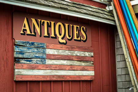 shop sign: An old fashioned antiques sign