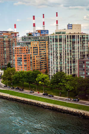 ed: NEW YORK-JULY 29-High rise apartments and the Con Ed smoke stacks along the the East River on Roosevelt Island on July 29 2014 in New York City  Editorial