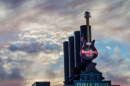hard rock cafe: BALTIMORE, MARYLAND-SEPTEMBER 28-Super large guitar on the old factory now the Hard Rock Cafe on the Inner Harbor September 28 2014 in Baltimore Maryland.