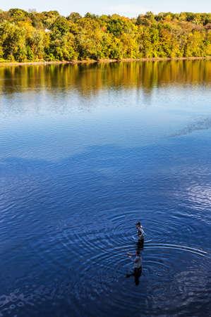 WASHINGTON CROSSING, PENNSYLVANIA-OCTOBER 12-Men fishing in the Delaware River in Washington Crossing State Park on Oct 12 2014 inPennsylvania.