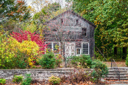 An old barn and colorful Autumn leaves in Frenchtown, Hunterton County, New jersey.