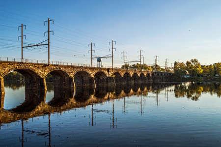 The Morrisville Trenton Railroad Bridge over the Delaware River in Trenton New Jersey. photo