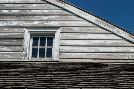 peeling paint: An exterior of a historic home with peeling paint on wooden siding. Stock Photo
