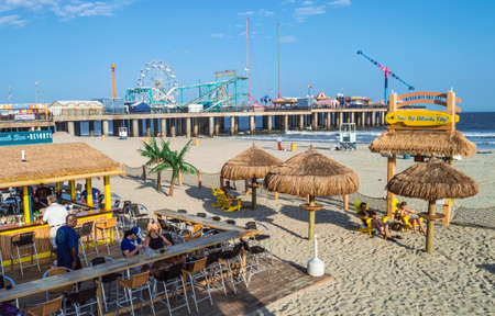 september 2: ATLANTIC CITY NEW JERSEY - SEPTEMBER 2: A beach bar with the amusement pier in the background on September 2 2014 in Atlantic City New Jersey. Editorial